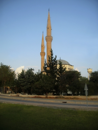 Mosque with a two high towers against blue sky photo