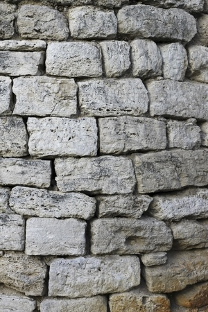solidity: Rough gray bricks with a textured surface