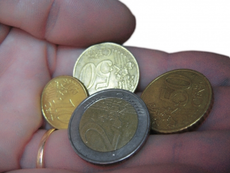 Euro coin and euro cents on the male hand photo