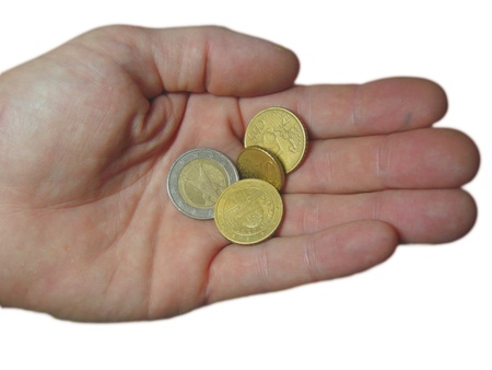 argentum: Euro coin and euro cents on the male hand Stock Photo