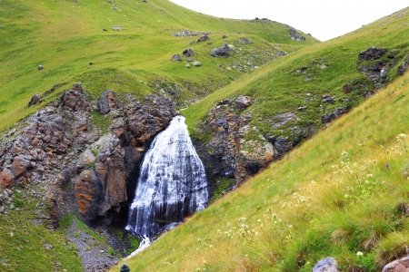 Waterfall Girlish Braids between the mountains of Northern Caucas photo