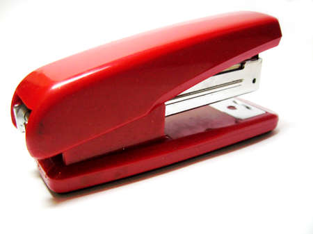 Red stapler isolated on the white background photo