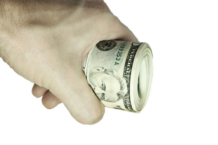 Mans hand holding a stacks of paper dollars USA on the white background photo