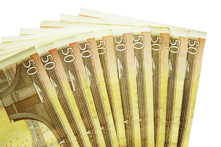 Stack of fifty euro banknotes isolated on the white background photo