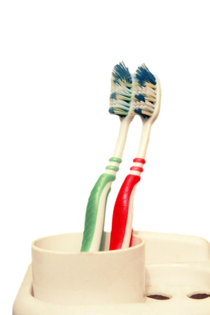 Green and red tooth brushes isolated on the white background Stock Photo