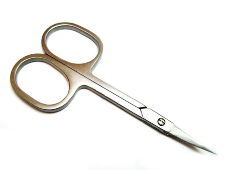 Manicure scissors isolated on the white background photo