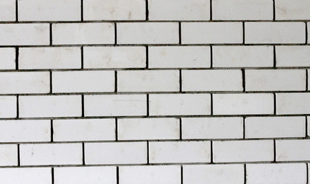 Seamless Background Photo Texture Of Gray Rough Brick Wall photo