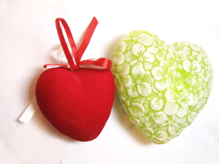 Green and red valentine heart isolated on the white background photo
