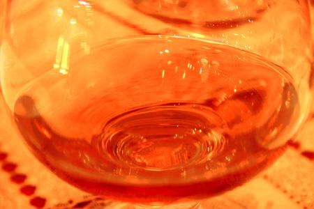drunks: Glass of cognac still on the table in restaurant