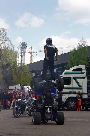 freeride: Moto free style pilot stunting on the square - Pyatigorsk, Russia, Opening of moto season 2015 on 1st May 2015