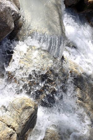 range of motion: Wild mountain river flowing in the canyon Stock Photo