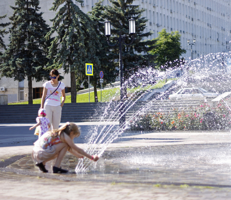 Children near a splashing fontain in the center of town 12 June 2016 Pyatigorsk, Russia, Town Square