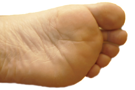 Womans foot on the blue and yellow background