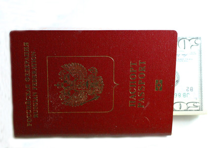 Russian Passport And Dollars USA Isolated On White Background Stock Photo