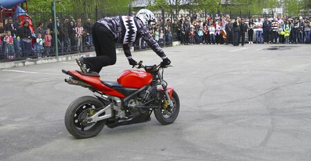 Moto free style pilot stunting on the square - Pyatigorsk, Russia, Opening of moto season 2015 on 1st May 2015