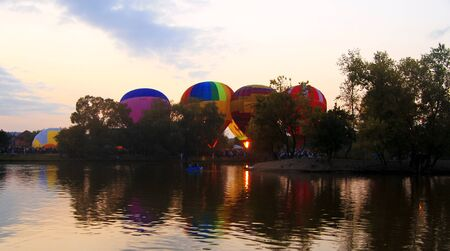 Hot air baloons flying in the evening sky near the lake 14 september 2014 Russian Federation Pyatigorsk, Central park Stock Photo