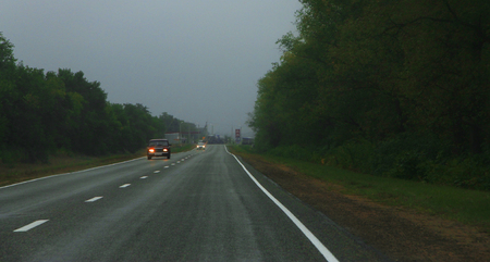 Highway landscape with moving cars at daytime