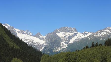 Caucasus mountains summertime. The Dombai mountain landscape Stock Photo