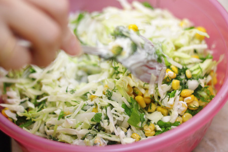 Fresh salad with canned corn, cabbage and parsley