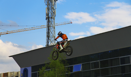 Moto stuntrider pilot stunting in the park - Pyatigorsk Russia Opening of moto season 2015 on 1st May 2015 Editorial