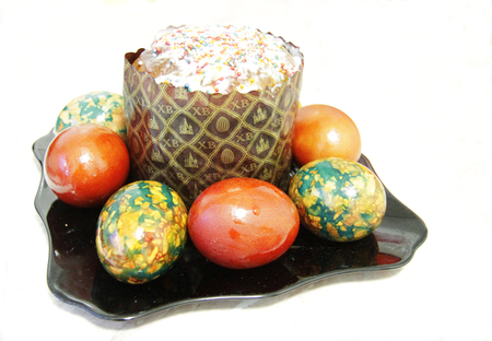 Easter Cake and colorful painted eggs on the black plate