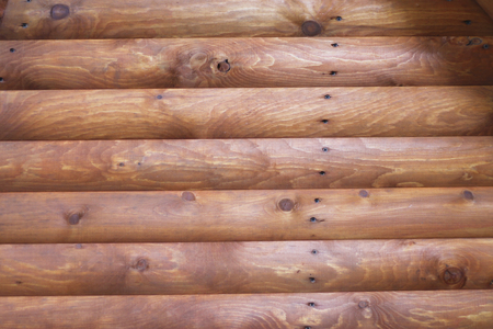 A Wooden background textured horisontal pattern in brown colors with logs Stock Photo