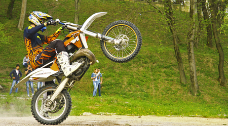 Moto stuntrider pilot stunting in the park - Pyatigorsk Russian Federation Opening of moto season 2015 on 1st May 2015 Redakční