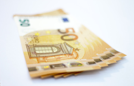 Stack of 50 euro banknotes laying isolated on white background