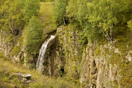 Honey waterfalls and caucasus mountains of North Caucas, South of Russian Federation