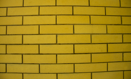 Yellow old grunge brick wall stone modern texture background horisontal position