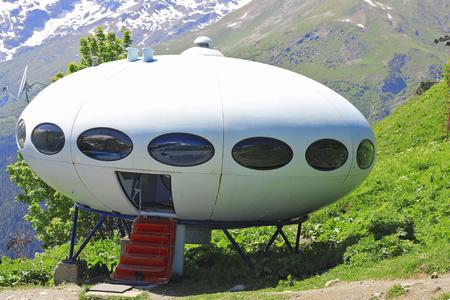 UFO and Caucasus mountains landscape summertime. Dombai nature, Russian Federation