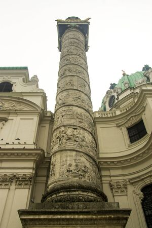 Column of St. Charles Church - Karlskirche, Karlsplatz in Vienna, Austria 05 november 2018 Фото со стока