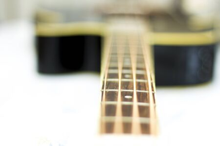 An acoustic bass guitar close-up isolated on the white background