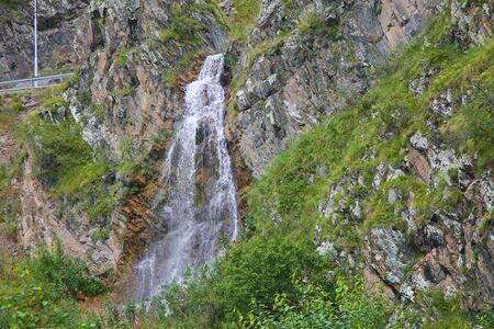 Waterfall flowing down between a caucasus mountains of North Caucasus, South of Russian Federation