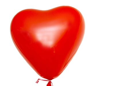 Valentine Day big red heart balloon with ribbon isolated on the white background Imagens