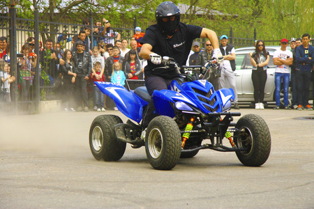 Moto free style pilot of quad bike stunting on the square - Pyatigorsk Russia Opening of moto season 2015 on 1st May 2015