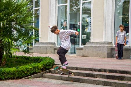 Teen training on skate board. Sochi, Russian Federation 2020 september 06