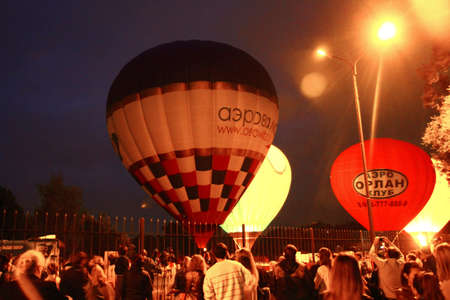 Hot air baloons flying in the evening sky near the lake 15 september 2013 Central park, Pyatigorsk, Russian Federation
