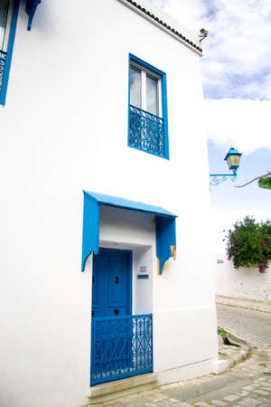 House on corner of street White and blue design town Sidi Bou Said, Tunisia, North Africa 09 october 2018 Stock fotó - 158232324