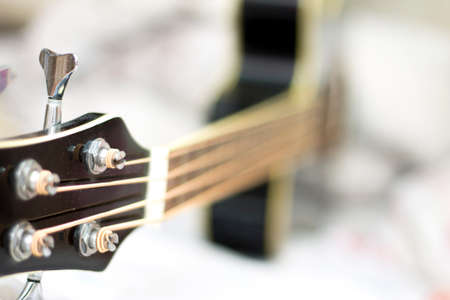 An acoustic bass guitar closeup isolated on the white background Stock fotó