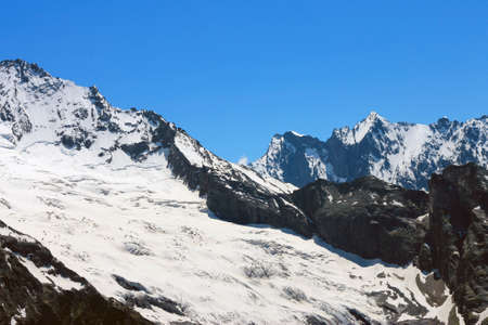 Dombai Mountains Peaks Under Snow And Clear Blue Sky Stock fotó