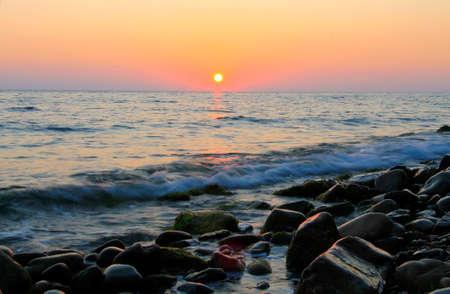 Beautiful sunset Over The Sea. Evening on the seashore. Black sea seaside
