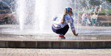Children playing near a splashing fontain in the center of town 12 June 2016 Pyatigorsk, Russia, Town Square