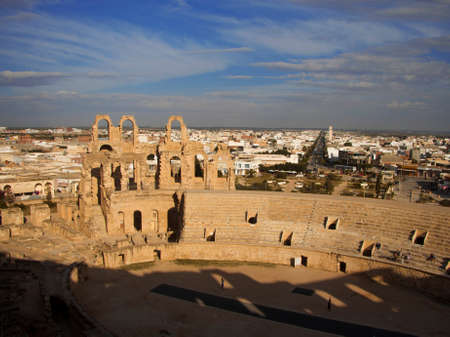 General arial view of Coliseum of El Jem Tunisia and modern town background. Ancient amphitheater in North Africa 13 oct 2018
