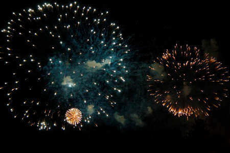 The Celebration colored firework flashing in the black night sky background Stock fotó