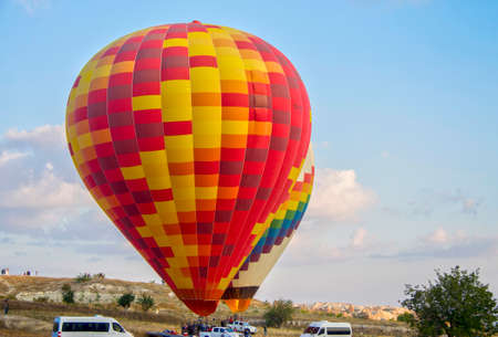 Colorful hot air balloons against blue sky starting to fly over Cappadocia, Turkey 27 september 2019