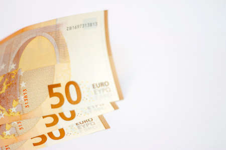 Stack of Fifty euro banknotes laying isolated on white background