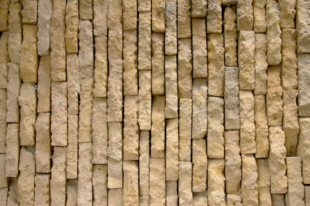 Yellow old grunge brick wall Stone Vintage Texture Background horizontal position