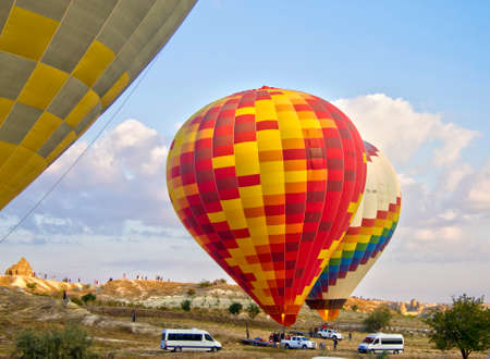 Multicolored hot air balloons against blue sky starting to fly over Cappadocia, Turkey 27 September 2019