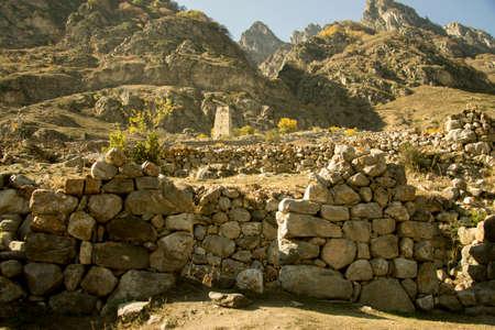 Ancient ruin of Kunlyum village at Autumn in Cherekskoe gorge, Upper Balkaria, North Caucasus, Russian Federation